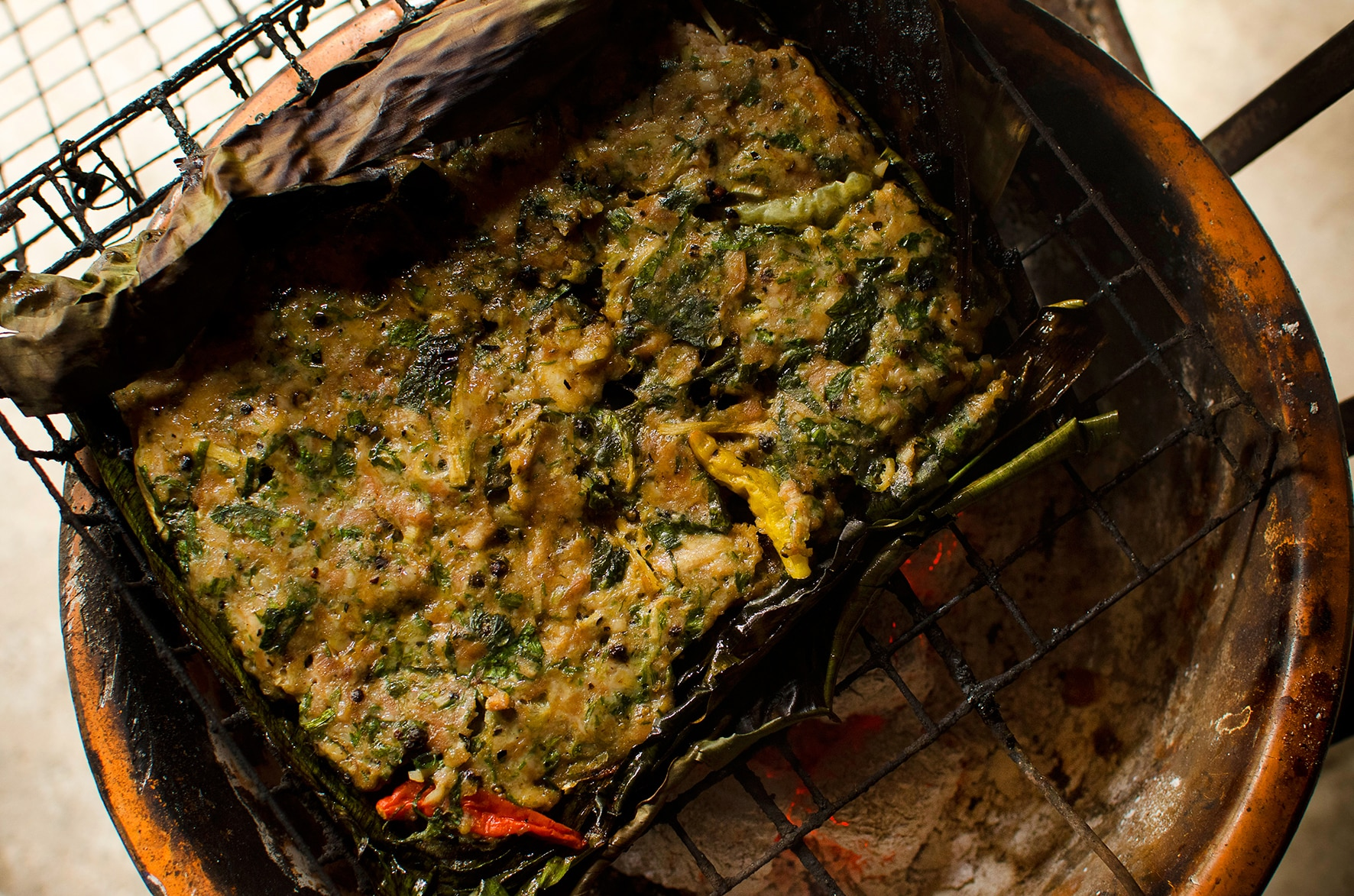 Chargrilled banana leaf filled with chicken and Asian herbs recipe  SBS Food