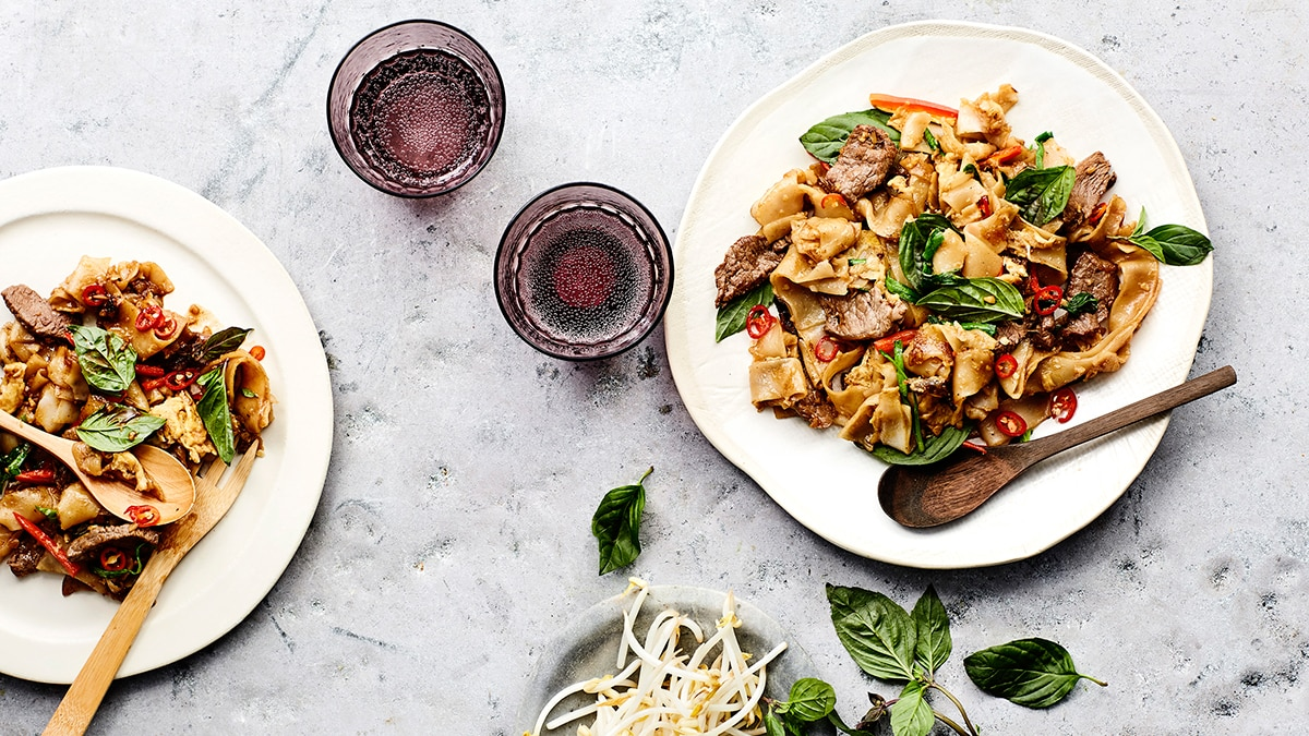 Pad kee mao stirfried rice noodles with beef holy basil