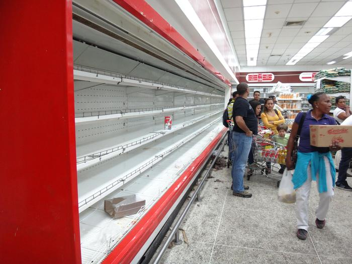 Empty shelves at a supermarket in Caracas.