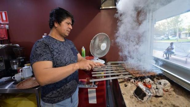 Ali is cooking kebab in his restaurant