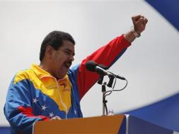 Venezuela's acting President Nicolas Maduro gestures to supporters after he registered as a candidate for president in the April 14 election outside the national election board in Caracas