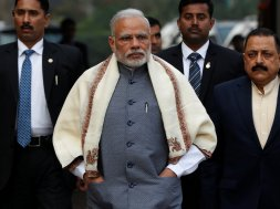Prime Minister Modi walks to speak with the media as he arrives at the parliament house to attend the first day of the budget session, in New Delhi