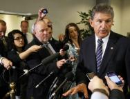 Manchin talks to reporters outside of a closed-door Senate Armed Services Committee briefing on the Bergdahl prisoner swap at the U.S. Capitol in Washington