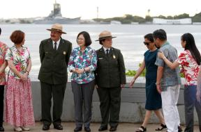 Taiwan's President Tsai Ing-wen stands with delegates and park service members at the USS Arizona Memorial at Pearl Harbor near Honolulu, Hawaii