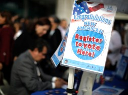 Immigrants sign up to vote in the upcoming midterm elections after participating in a naturalization ceremony to become new U.S. citizens in Los Angeles