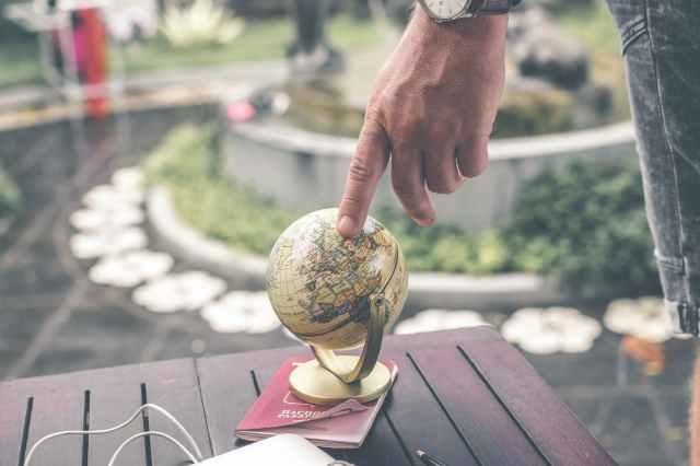micro niche affiliate marketing - person holding terrestrial globe scale model taken