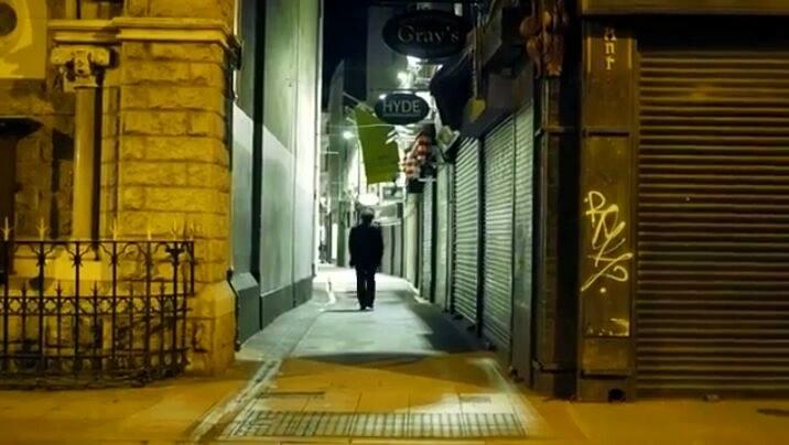 Lonely figure walking down Dublin Street