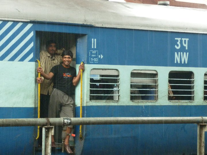 local travel in India - trains in the rain