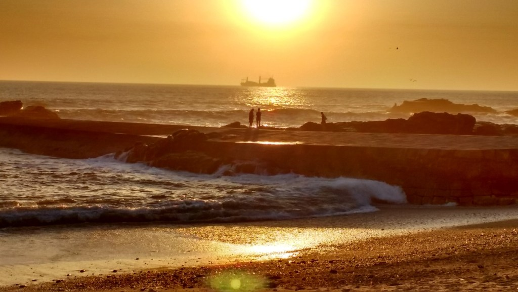 the beach in Porto at sunset