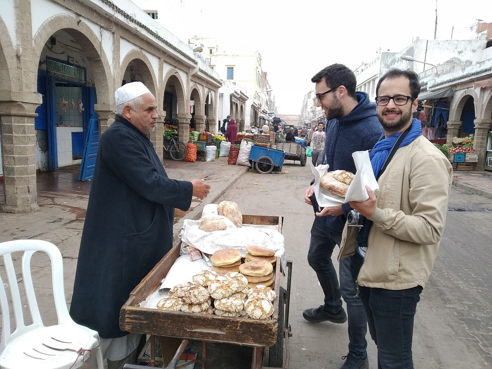 buying bread from a street trader early in the morning