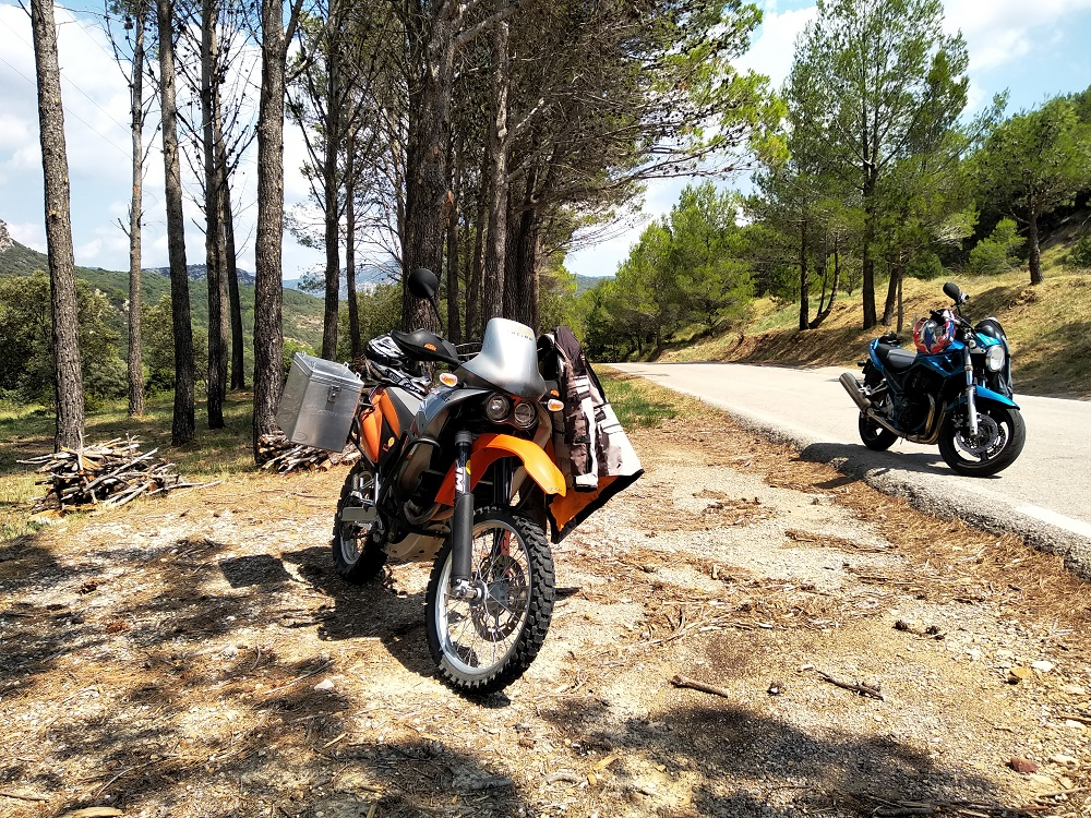 motorbikes parked under the trees on a tour in Spain