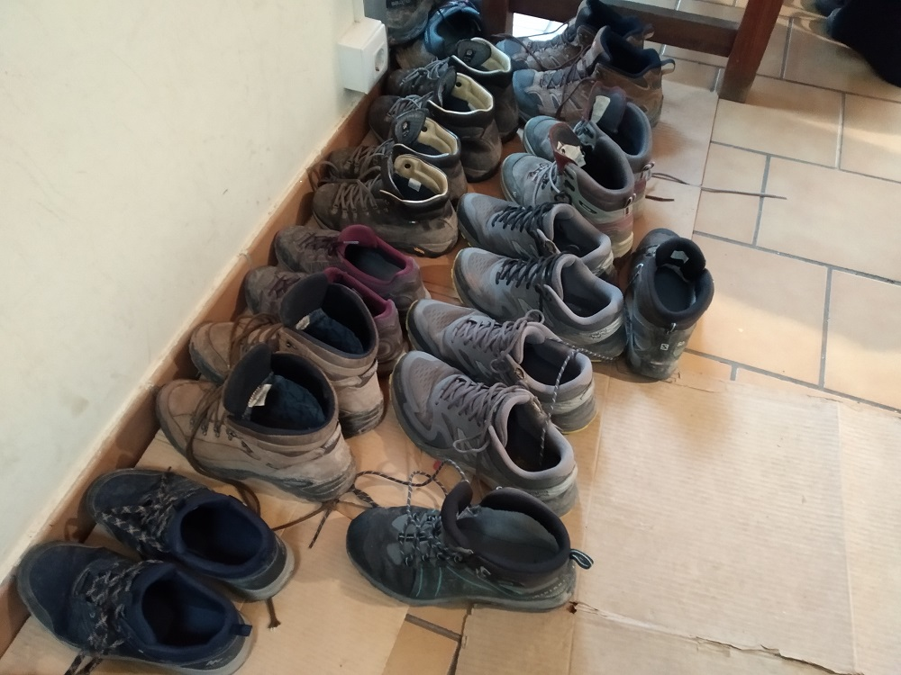 walking boots lined up outside a hostel