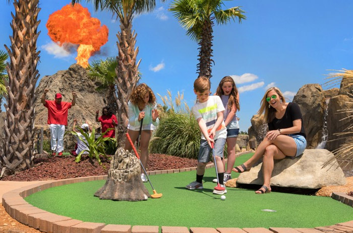 A family playing golf at Lava Links. Hole in one!