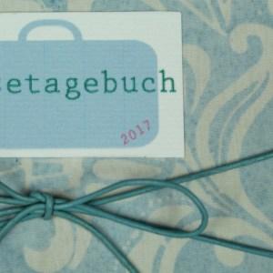 Hellblau weiß gemustertes Reisetagebuch
