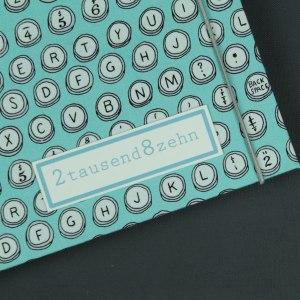 Buchkalender 2018 türkis grau mit Buchstabendruck