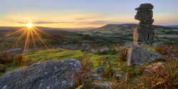 Stunning image of Bowermans Nose granite rock formation near Hayne Down on Dartmoor at sunset