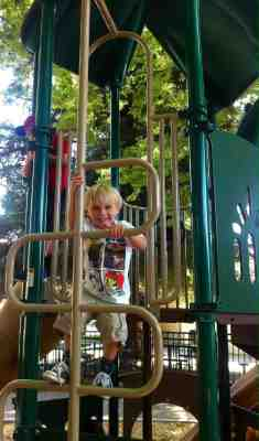 Taber Livesey climbs a playground ladder during free time.