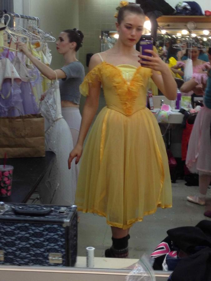 "Sophomore Camille Locke takes a selfie in her ""Waltz of the Flowers"" costume."