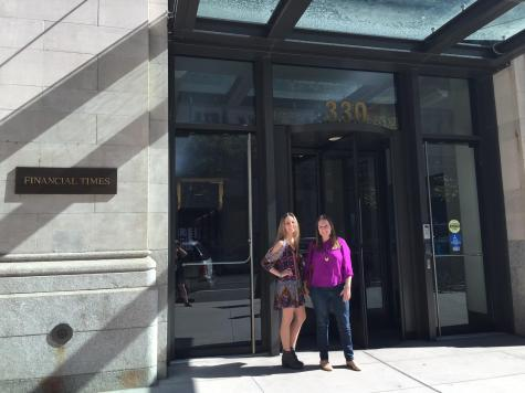 Larrabee and her cousin, Kelsey Blodget, '04, stand outside the office building where Larrabee interns for TripAdvisor in SoHo, New York.
