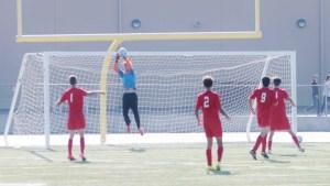 Goalie senior Brad Petchauer saves a potential Waldorf goal.