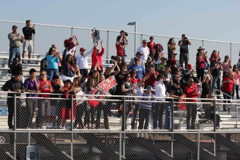 Fans cheer for the Cavs as they take on the Waves.