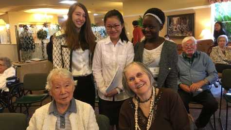 After their performance, freshmen Chardonnay Needler, Allison Zhang and Brandy Riziki interact with the residents.