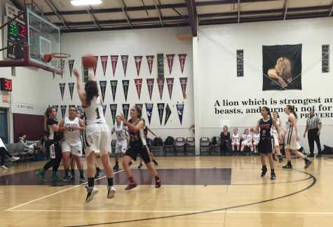 Junior Natalie Brown closes out on a Valley Christian shooter in the varsity girls' game, Feb. 2. The Cavs