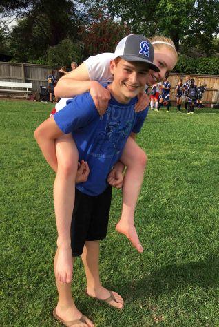 Freshmen Jack Christian gives a piggy-back ride to injured senior Emma Belliveau, as she sustained a major ankle injury.