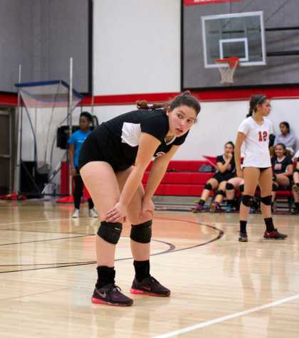 Senior Alexa Mathisen gets into position to receive a serve from Big Valley Christian.