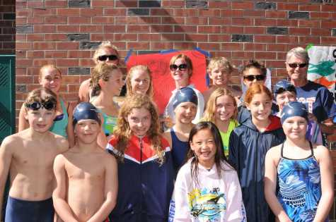 Rebecca Waterson (front row, third from the left) and coach Debbie Meyer (back row, right) take a group picture with the rest of the Truckee Tahoe Swim team at the Junior Olympics in Roseville on March 4, 2012.