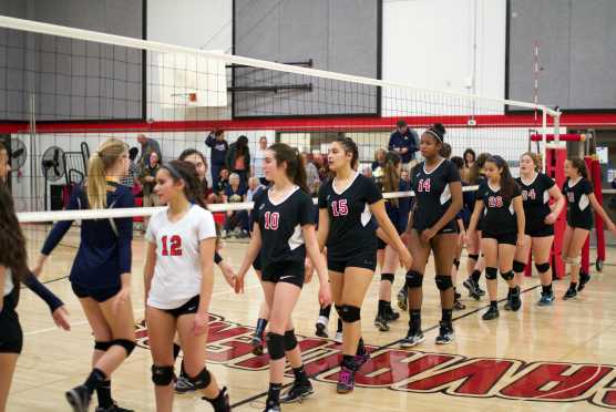 Junior Katia Dahmani, sophomore Tori Van Vleck, junior Yasmin Gupta, freshman Monet Cook, senior Kaeleigh Valverde and sophomores Bella Mathisen and Lia Kaufman high five Big Valley Christian players after losing their match.