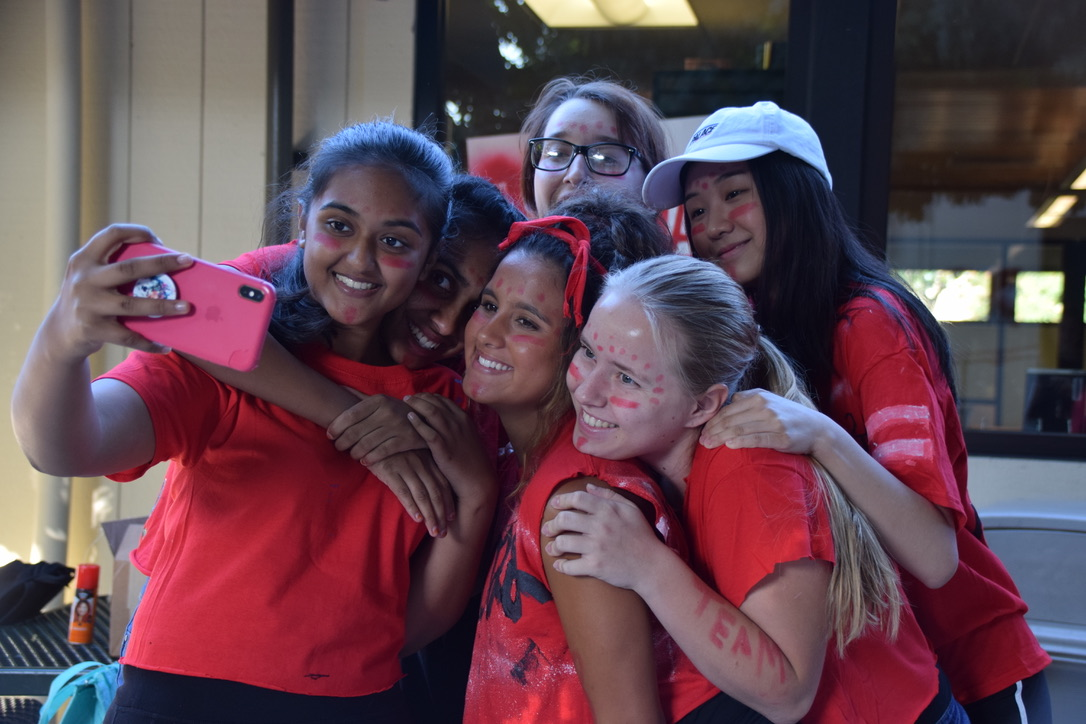 Sophomore Arikta Trivedi takes a selfie with teammates. (Photo by Maddie Woo)