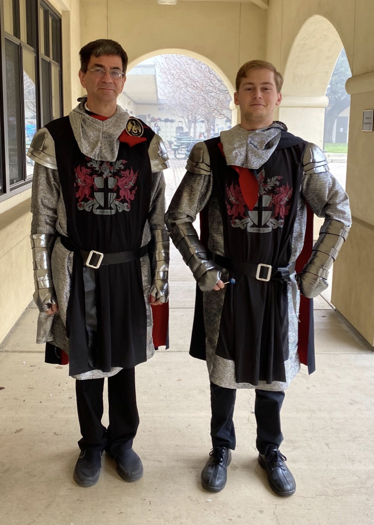 Physics teacher Glenn Mangold and a senior sport matching knight costumes for twin day.
