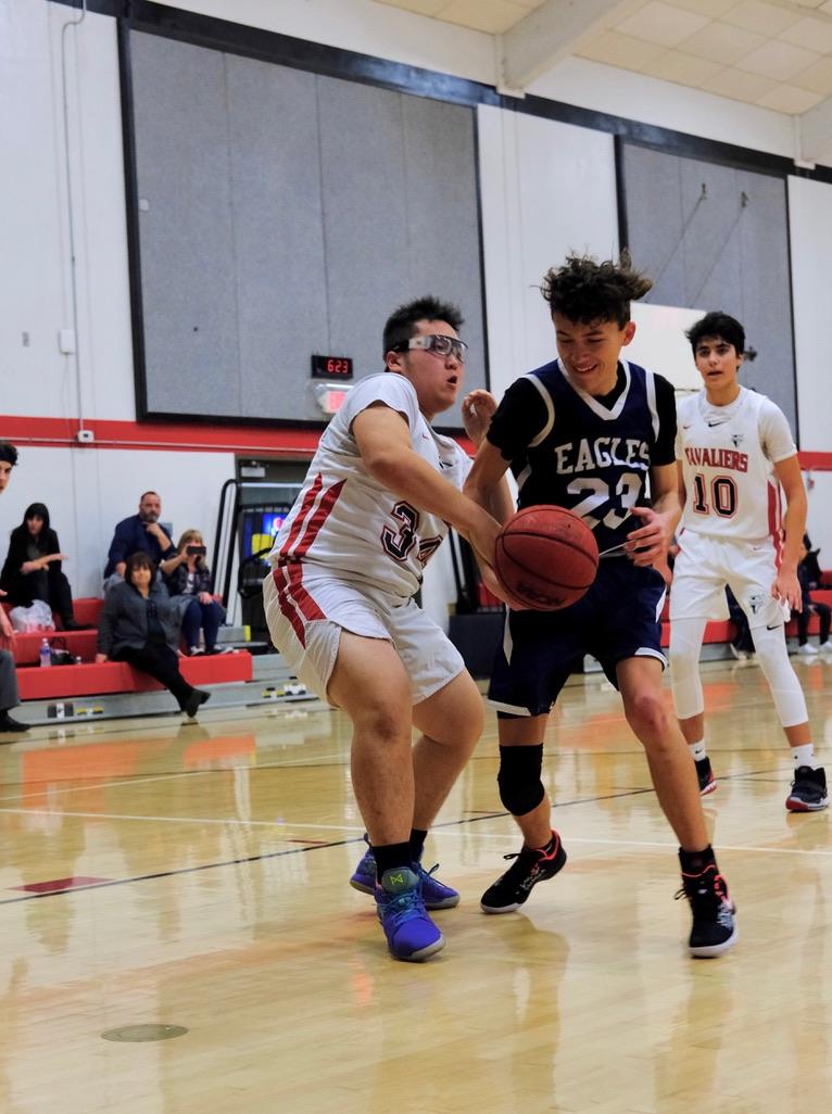 Junior forward Martin Cao swipes the ball away from an El Dorado Adventist Eagle.