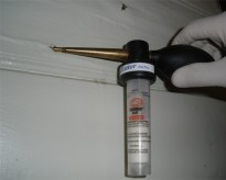 Treating live termites inside a house with Termidor powder