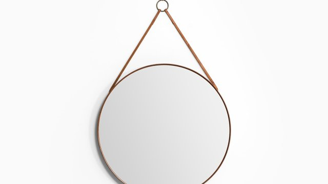 Round mirror in teak and leather by Glas mäster at Studio Schalling