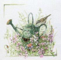 punto-croce-annaffiatoio-tra-fiori-e-uccellini.pdf