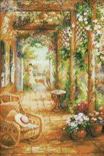 schema punto croce quadro pergola fiorita con sedia a dondolo