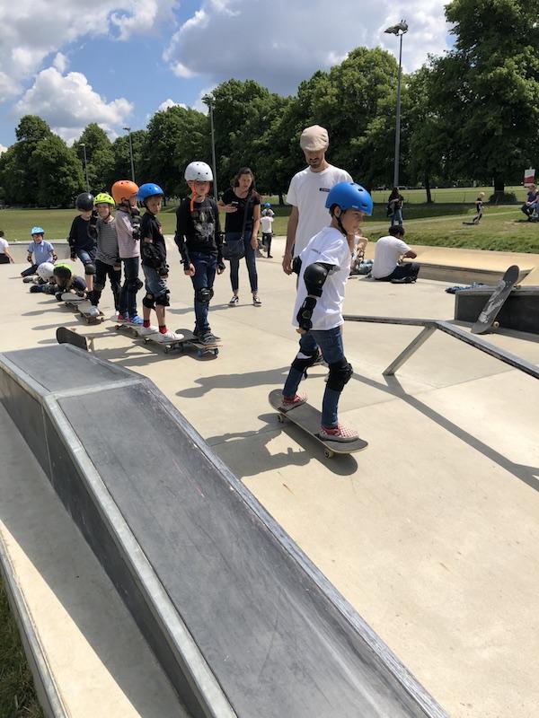 Rolling down bank on skateboard
