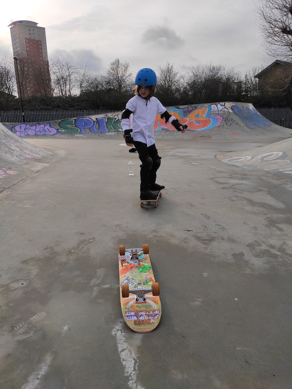 Isaac steering on his skateboard