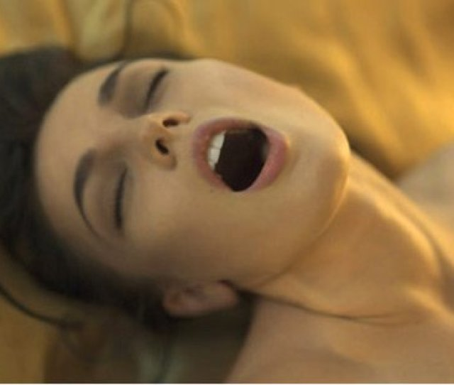 A Woman Screaming With Pleasure From An Orgasm
