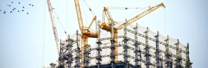Construction site and equipment to represent mergers in the industry
