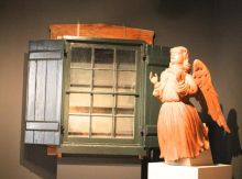 Angel statue and window