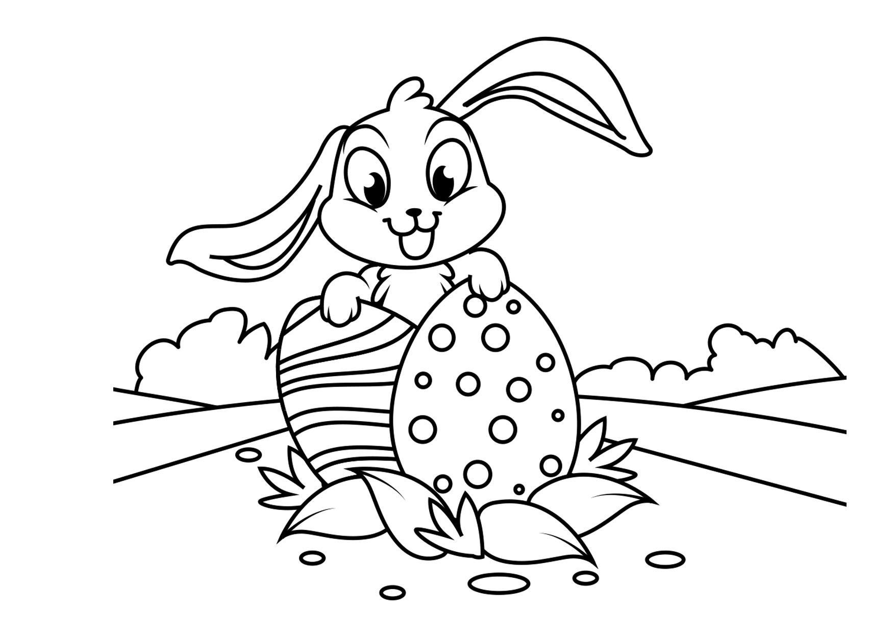 Malvorlage Osterhase mit Ostereiern - Kostenlose