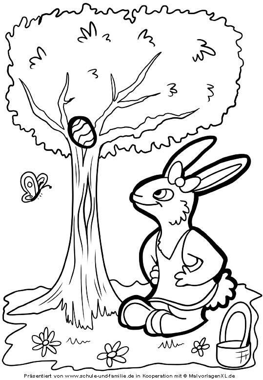 Kostenlose Malvorlage Ostern Osterhase versteckt ein Ei