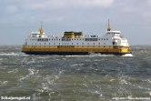 De Schulpengat onderweg naar Den Helder bij een ruwe zee.