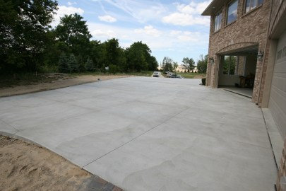 Plain concrete driveway with brushed swirled texture
