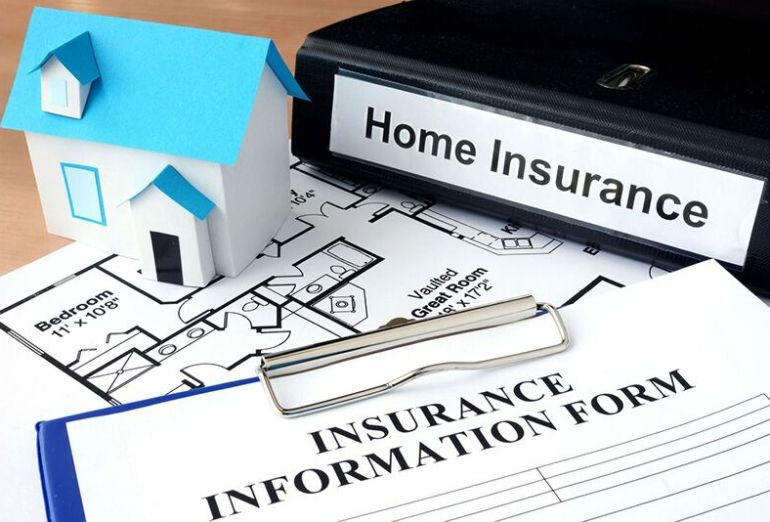home insurance paperwork and binder