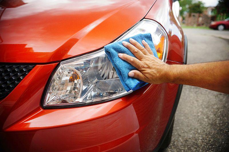 wiping down car exterior