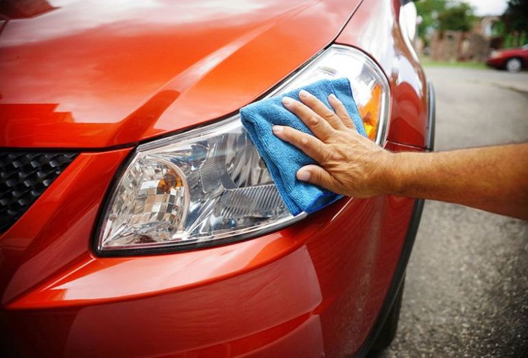 wiping down car exterior